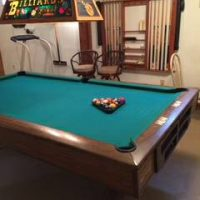 Brunswick Pool Table With Light and Custom Cue Rack